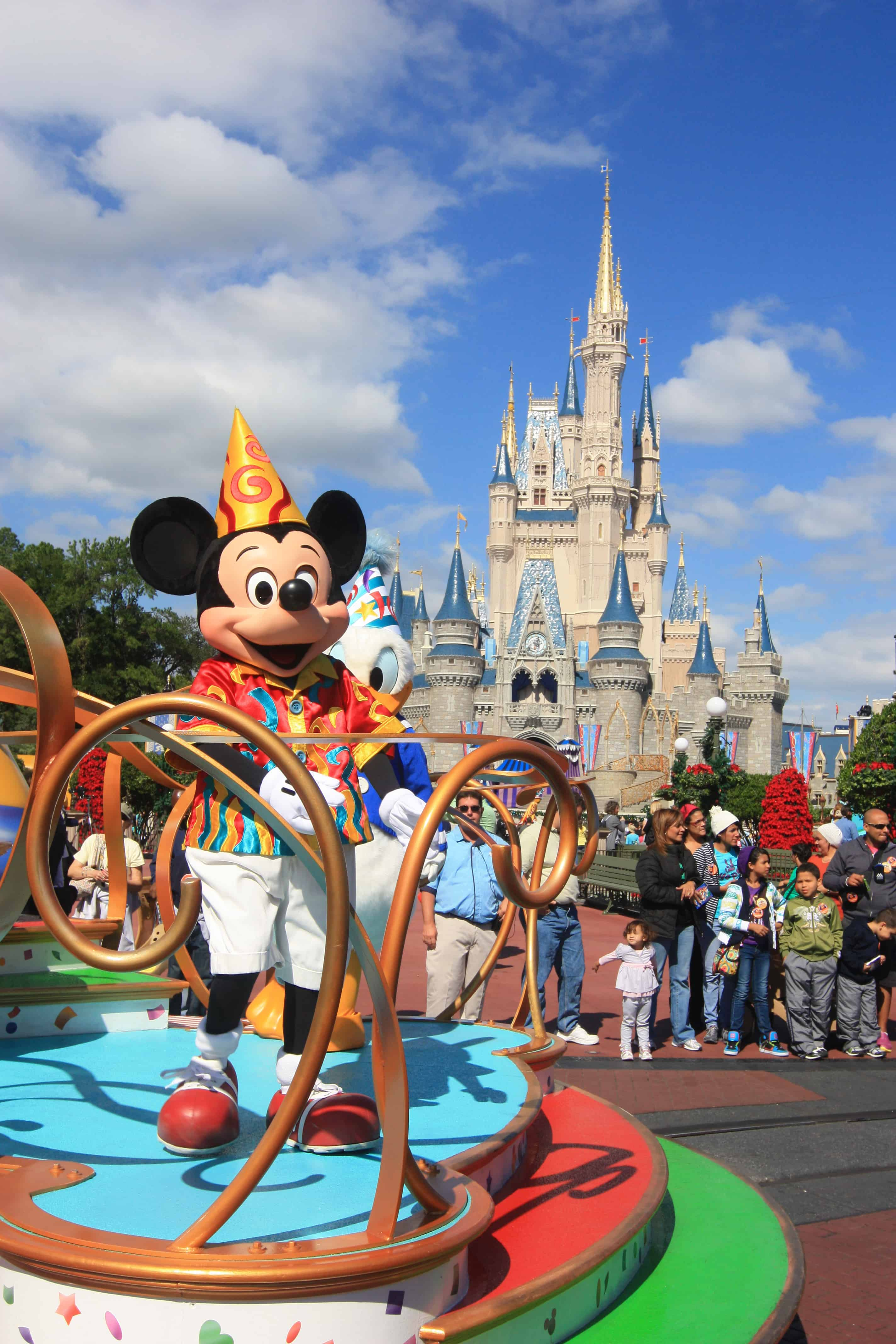 mickey in front of magic kingdom